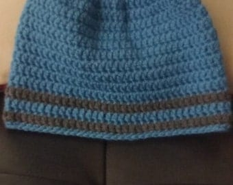 Men's beanie hat in sky blue with charcoal gray stripes. . .