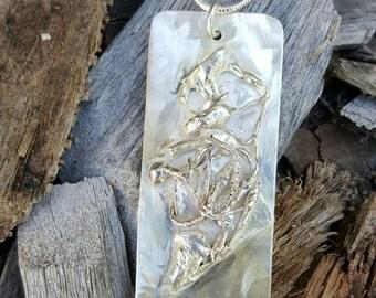Sterling silver pendant. Freeform design