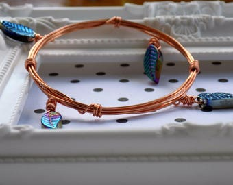 Copper colour bangle with rainbow coated leaf charms
