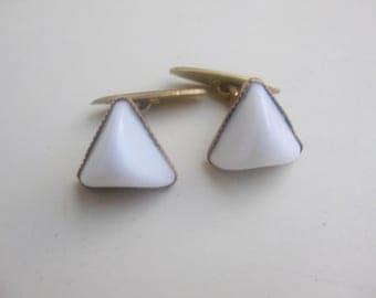 Org. 50 j. White glass cufflinks