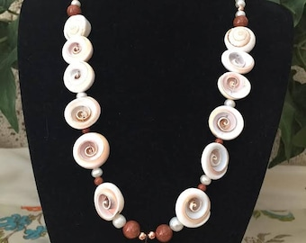 Natural Seashells, Freshwater Pearls and Goldstone Necklace With Copper Accents.