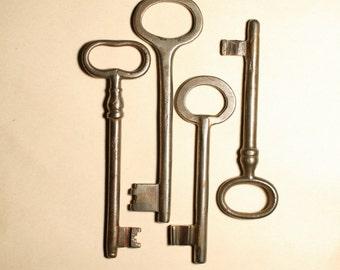 Set of 4 big vintage iron skeleton keys