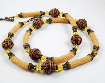 Ethnic pale orange necklace with wood beads/rustic/tribal/beaded necklace