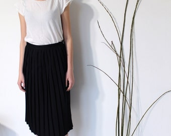 Black Pleated Skirt, Feminine button detail,