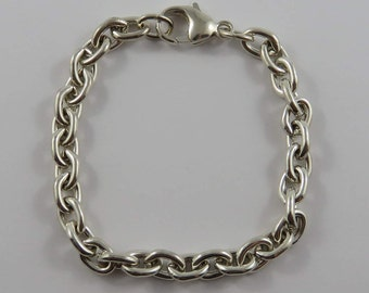 Sterling Silver 7 Inch Solid Oval Link Bracelet With A Lobster Style Clasp