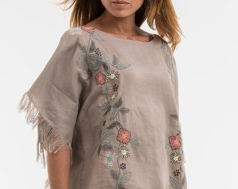 "Poncho ""OPTIONS"" noble based on a 100% linen, we did run a romantic embroidery in white or taupe."