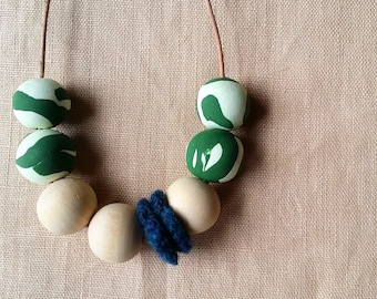 Polymer clay beaded necklace with wooden beads and crochet flower detail. Blue and green necklace. Unique necklace. Polymer clay jewelry