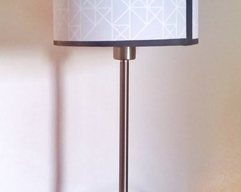 "Pastel blue cylindrical lampshade, geometrical pattern. 20x15cm (approx 8""x6"")."