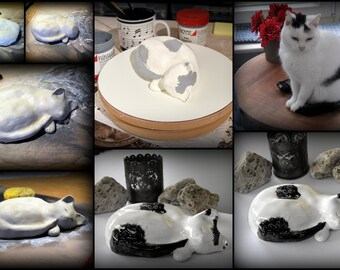 Ceramic cat figurine .... R.I.P.. ...