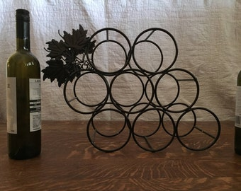Wire wine rack with metal grape leaves Vintage rack holds eight bottles