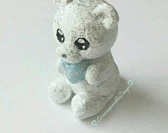 Sparkly white bear sculpture