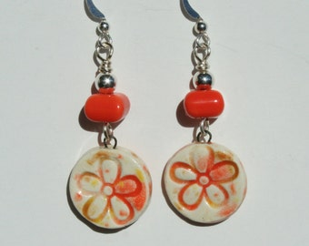 Polymer clay charm earrings with orange flower