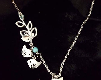 Multiple birdie necklace with faux Turquoise.