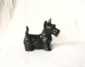 Black glossy picture of dog, schnauzer.  Vaga international.