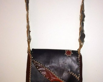 Hand stitched recycled leather bag
