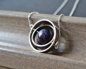 Spinning little planet with 12mm Goldstone necklace