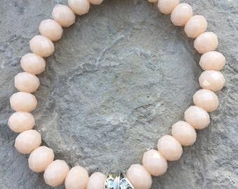 Peach and silver cross bracelet