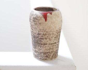 Decorative raku pot with glaze detail