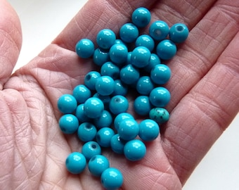 1 dozen small turquoise beads - glass