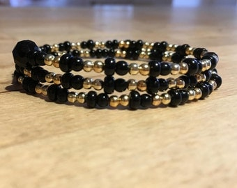 Black and gold memory wire bracelet and earrings set