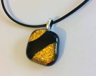 Sparkly black and gold fused glass pendant