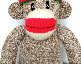 Traditional red heel Sock Monkey with green and red festive xmas hat