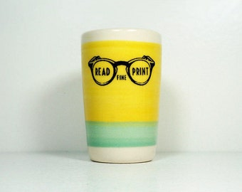 itty bitty cylinder / vase / cup with a Read (the) Fine Print print on a colour block of Yellow & Blue Green, Ready to Ship