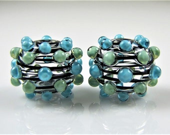 Black Swirl Hollow Glass Beads with Green and Blue Dots