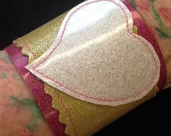 Sale!  Sparkle vinyl heart cuff. XoXo