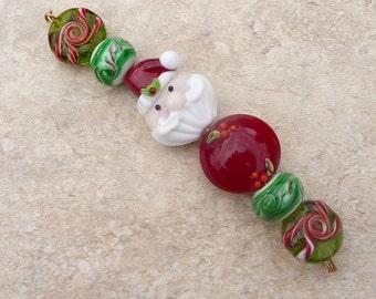 Handmade Lampwork Christmas Holiday Santa St Nick Holly Candy cane Winter Snow Artisan bead Generationslampwork SRA