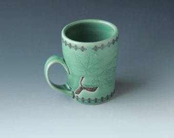 Clay Maple Mug - green ceramic porcelain cup with seedpods, leaves, and wifi decals - handmade wheel thrown pottery