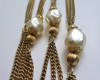 Faux pearl flapper necklace. long multi strand faux pearl necklace. waist length necklace