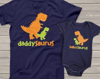Dinosaur theme daddysaurus and babysaurus matching dad and kiddo DARK t-shirt or bodysuit gift set - great gift for Father's Day MDF1-017v-2