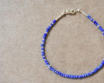 tiny lapis lazuli bracelet. delicate blue lapis lazuli bracelet. cobalt blue lapis lazuli jewelry. thin lapis bracelet with gold detail