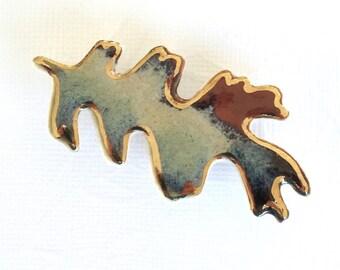 Porcelain Oak Leaf Brooch. Rust,  Blue-Green, Tan, Brown & Denim Blue. Ceramic. Sienna. Teal. Khaki. Beige. 22K Gold Decoration.