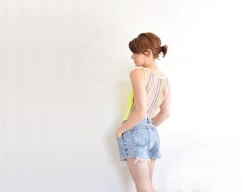 high waist Jordache cut off shorts . frayed light blue jean cotton denim .medium.large