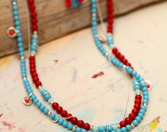 Multi Beaded Strand Necklace With Dangles In Turquoise, Red and Coral
