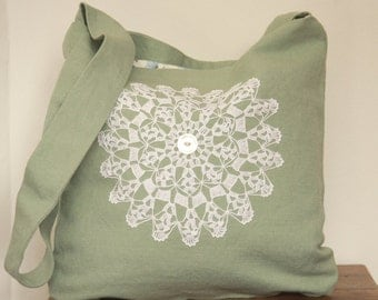 Green crossbody bag with vintage lace