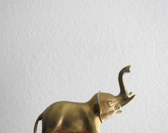 mid century solid brass elephant figurine with large ears