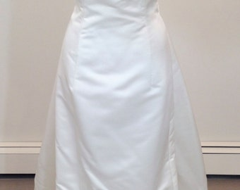 This is a fabulous sheath styled wedding dress by Carmela Sutera sz6