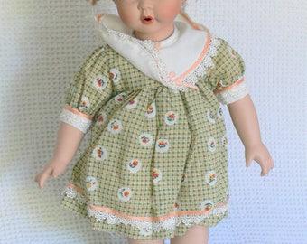 un marked  porcelain doll