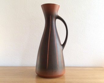 Sleek fluted West German pottery vase in brown and orange with incised striped decoration. Form number 1352 35.