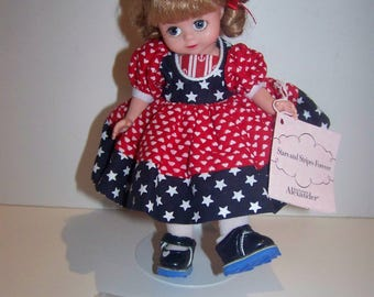 Stars and Stripes blonde Madame Alexander 8 in doll with flag garland