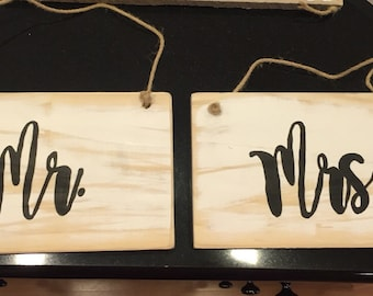 Mr. And Mrs. Hanging reclaimed wood signs . Perfect for your wedding to hang on chairs or anywhere tou can think ! Set of 2