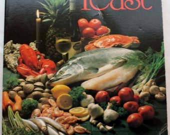 A Fish Feast/ Soft Cover Book/Fish Cookbook/Seafood Recipes/by Charlotte Wright/1980s