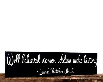 Wood sign saying - Well behaved women seldom make history sign