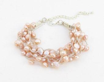 Pink peach freshwater pearl bracelet on silk thread, knit bracelet, silver silk thread, multi strands