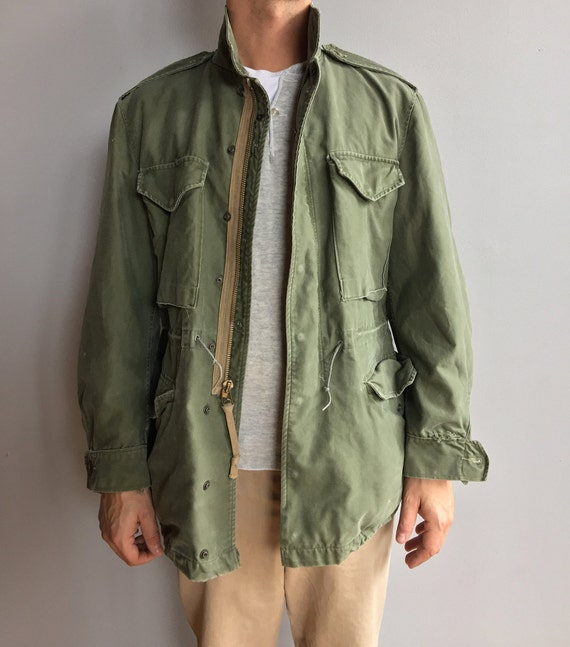 Faded M-1951 Olive Green Field Jacket with four front pockets. Medium Regular.