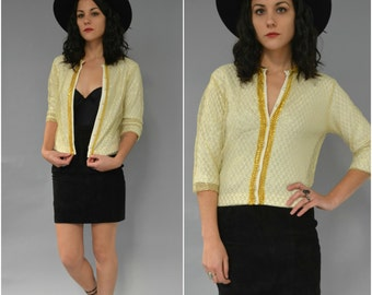 1950s gold netted and trimmed cardigan