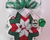 Christmas fabric Ornament - Quilted No-Sew - Poinsettia Tile White Metallic, red, and green sparkle fabric, fancy bow, and two jingle bells